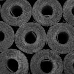 Closeup of Rolls of new black roofing felt or bitumen. Shallow depth off field